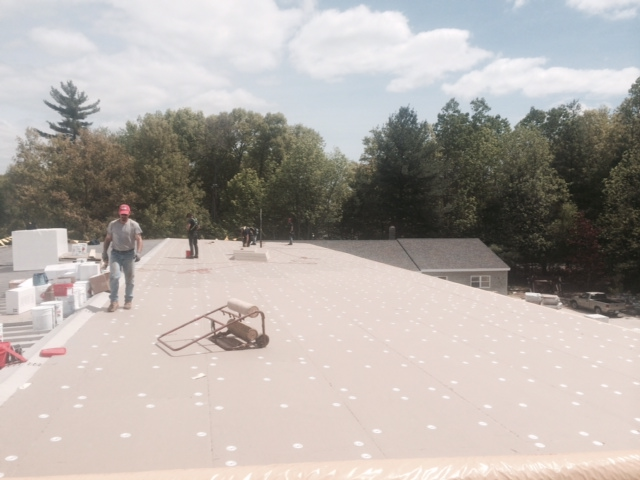 Roof replacement project at Sam White & Son's in Medfield, MA - Aqua Barriers, Inc.