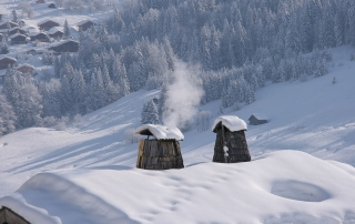 Winter chimney & roof with snow and mountains